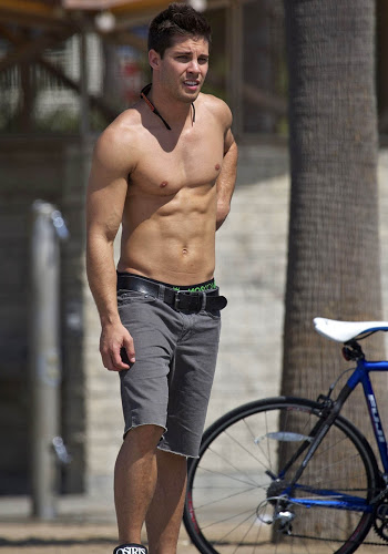 Dean Geyer shirtless while skateboarding in Santa Monica