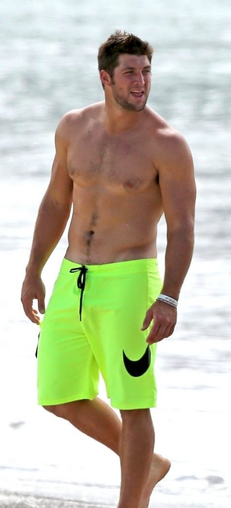 Shirtless Tim Tebow on the beach in Hawaii