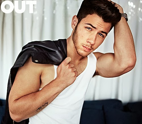 Nick Jonas and his biceps in a solo pose from OUT Magazine's feature on The Jonas Brothers