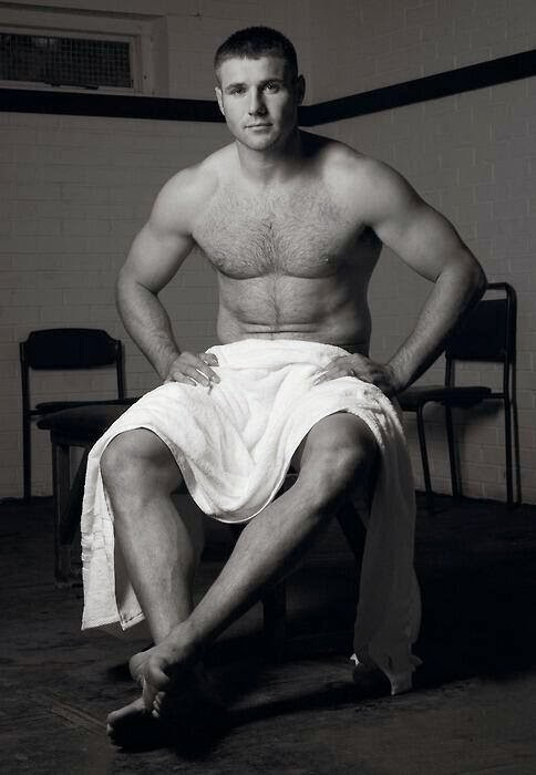 A young and shirtless Ben Cohen poses for the camera