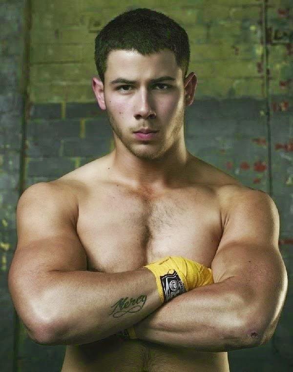 A shirtless and muscular Nick Jonas promotes his new TV series KINGDOM