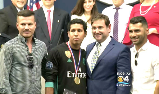 Helmut Muller Estrada (center) honored for defending a gay couple in homophobic attack after Miami Beach Gay Pride Parade