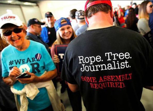 """Donald Trump supporter wears a t-shirt with the caption """"Rope. Tree. Journalist. Some assembly required."""""""