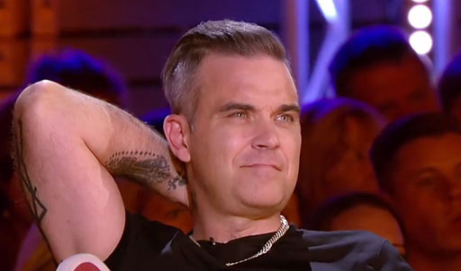 Pop star Robbie Williams caught heat for asking a trans singer's 'dead name'