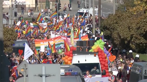 Rainbow-colored flags and banners were carried aloft for the parade by over a thousand LGBTQ participants gathered Saturday in Lublin as 300 right-wing haters blocked the parade's path.