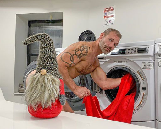 Broadway hunk & 'Daddyhunt' star Jim Newman (above) demonstrates that even Santa's elves have to do laundry some time...