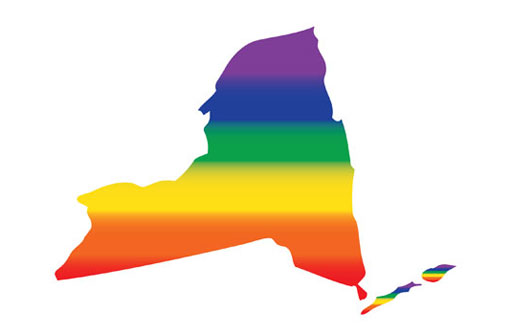 Thanks to new Democratic control of the New York state Senate, Gov. Andrew Cuomo was finally able to sign two important LGBT bills into law today.  With an American flag, a New York state flag, a rainbow flag and a transgender flag displayed prominently, the governor signed his name at a ceremony held at the New York City LGBT Community Center.