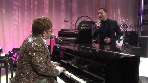 Elton John & Taron Egerton sing 'Tiny Dancer' raising millions for AIDS efforts around the world