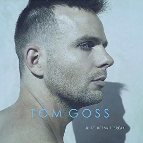 """Indie singer/songwriter Tom Goss shares his latest music video, """"Wake Alive.""""  Directed by Goss and acclaimed Baltimore-based artist Scott G. Brooks, the video literally visualizes the concept that we put ourselves in boxes.  And in doing so, find ourselves trapped in restrictive perceptions others have of us.  Says Goss, """"Only by bursting out can we live the free, vibrant lives we're meant to."""""""