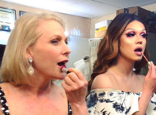 Democratic presidential hopeful Sen. Kirsten Gillibrand got a lesson in divadom at a Des Moines gay bar called Blazing Saddles, where she struck touched up her makeup to strike a pose with drag queens