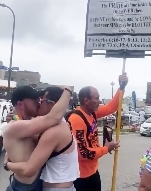 Two Pride attendees found they could get rid of a hater by simply kissing
