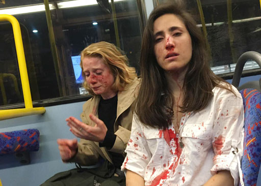 Four teenagers have been arrested in connection to a brutal homophobic attack on a London bus that left two women bloodied and severely injured.