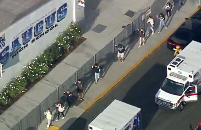 Students file out of Saugus High School after a reported shooting incident