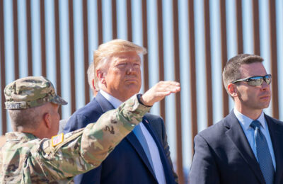 Donald Trump inspects his Mexican border 'wall' near San Diego (public domain)
