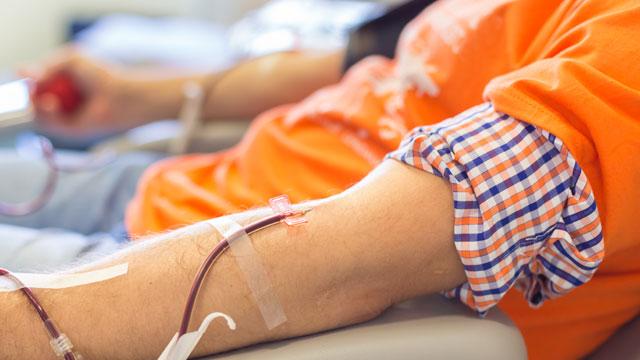 A young man donates blood (image via Depositphotos)
