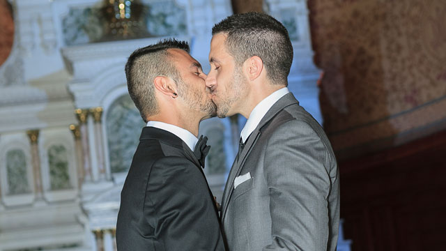 Two men kiss after getting married