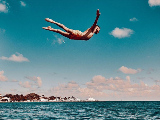 Two-time Emmy Award winning choreographer Travis Wall makes a high dive into the ocean