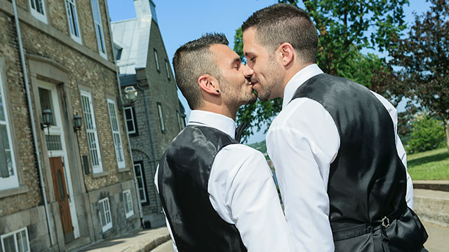 A couple kisses following a same-sex marriage ceremony