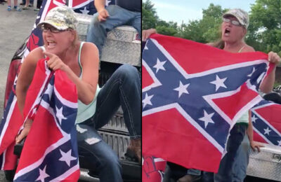Kathy Jenkins waves a Confederate flag at a Black Lives Matter protest