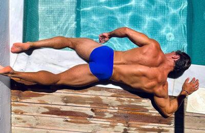Nicholas Budd lays by the pool in Mykonos