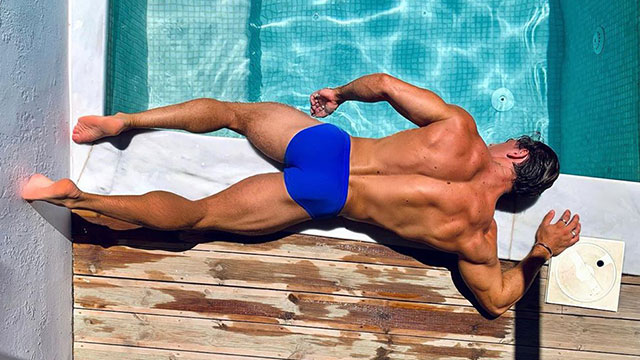 Nicholas Budd lays by the pool in Mykonos