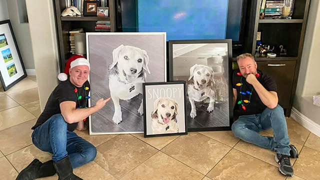 Michael and I pose with the multiple photos of Snoopy we gave each other