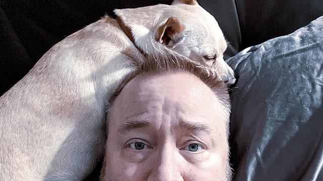 Scarlett sleeps on my head