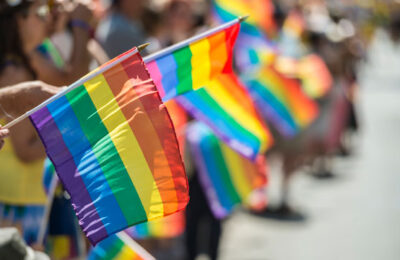 Rainbow flags waving at LGBTQ Pride event