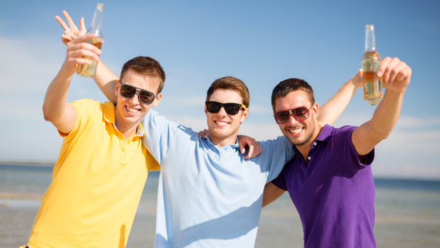 Three men drinking beer doing 'guy things'
