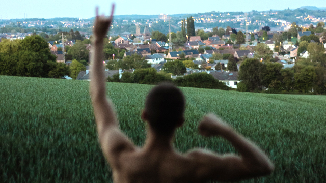 Shirtless man in a park