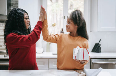 Photo of mother and daughter hitting 'high five'