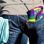 Teenager with Pride flag in back pocket - photo by Toni Reed