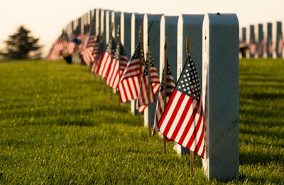 A field of US flags in a military cemetery