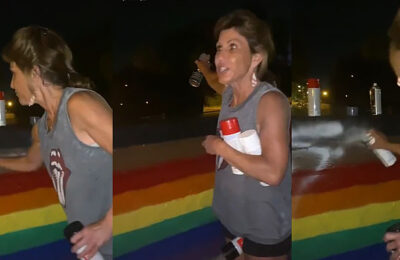 A woman identified as Tabitha Travis painted over a rainbow Pride display while berating young LGBTQs