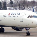 A Delta Airlines flight was forced to land mid-flight when an unruly passenger reportedly attempted to breach the cockpit