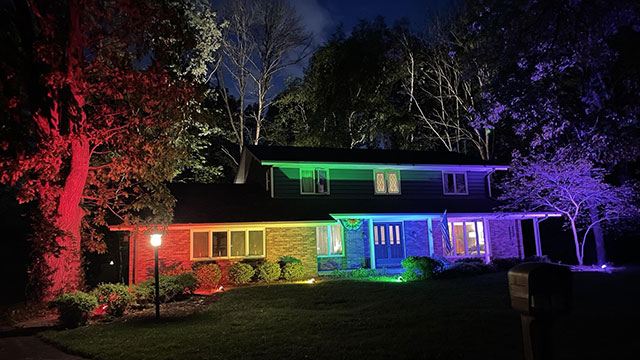 House lit up in rainbow lights during Pride Month