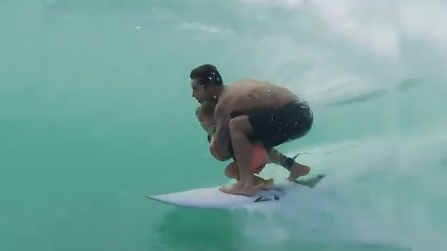 Pro surfer Billy Kemper and son Lion (screen capture)