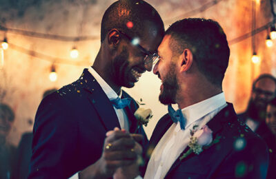 Gay couple dances after getting married