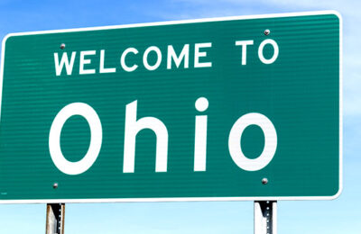 Stock image of a highway sign as you enter Ohio