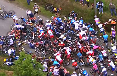 A French woman has been charged for causing a huge pile-up at the Tour de France over the weekend