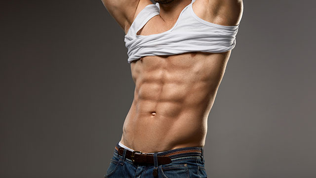 Stock image of a man taking off his t-shirt