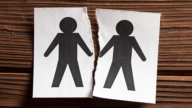Drawing of two male stick figures ripped apart representing gay divorce