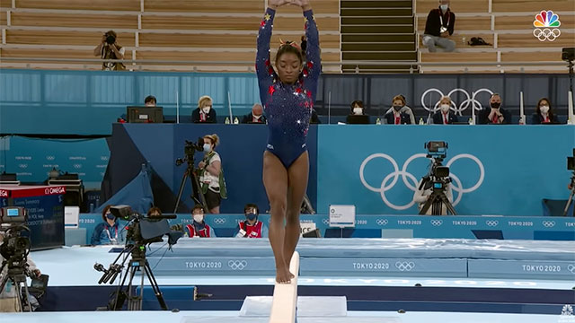 Screen capture of American gymnast Simone Biles competing on the balance beam in Tokyo