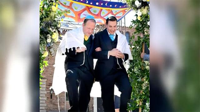 Gov. Jared Polis and Marlon Reis celebrate exchanging wedding vows