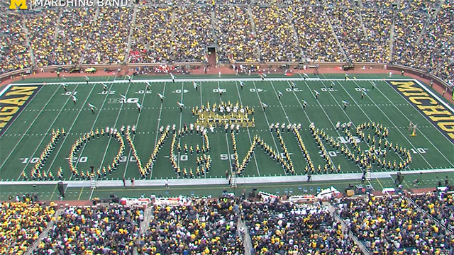 The University of Michigan marching band paid tribute to the school's Spectrum Center with a half-time show featuring music from Madonna, Lady Gaga, Cyndi Lauper and more