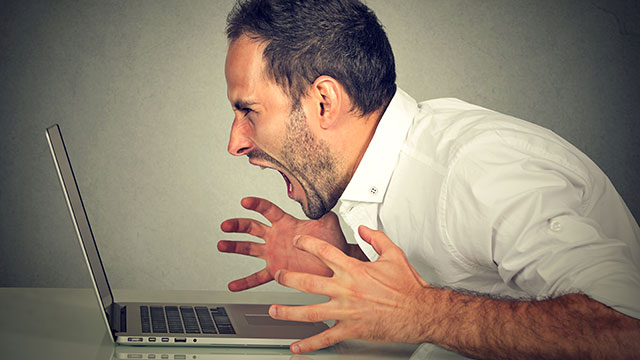 A man screams at his computer while Facebook and Instagram experience widespread outages